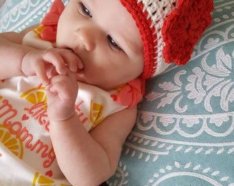 Baby Hat White with red trim and flower.