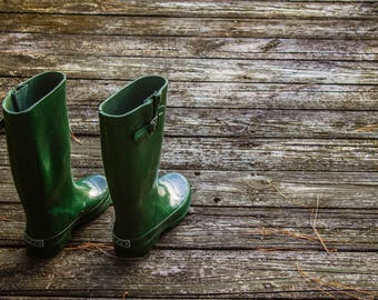 Green Rain Boots on the dock