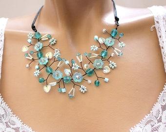 Blue flowering branch color fancy necklace.