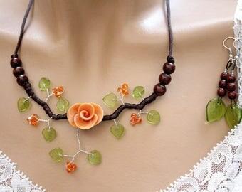 Orange/green/brown floral ornament