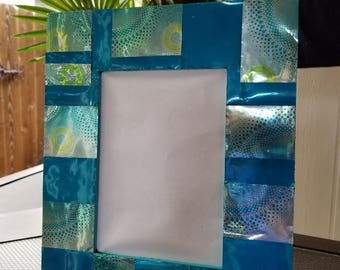 "Aluminum handmade 8x10 frame with 5x7"" opening by Denise Patterson"