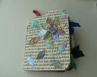 handmade journal for writing, sketching and painting in, with lots of pockets for secret keeping!