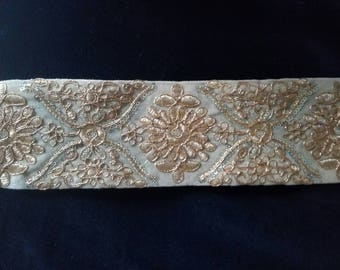 Embroidered lace gold patterns 8cms ecru background