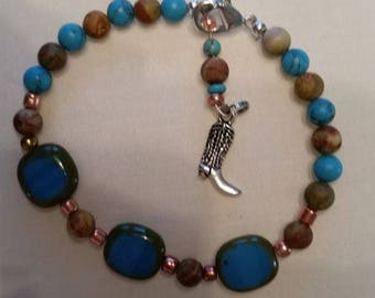 Beaded bracelet with cowboy boot charm