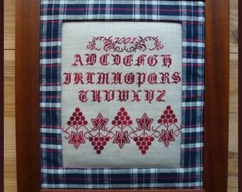 Large framed primer on linen and old kelsch cross stitch, using a wooden frame