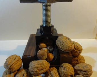 Screw nut cracker with solid wood base