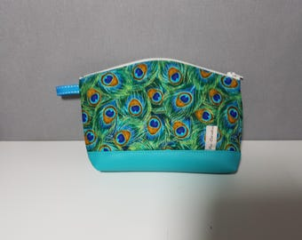 """Beautiful makeup bag faux leather fabric and turquoise blue """"peacock feathers"""" fully lined."""