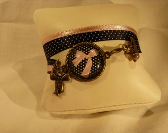 Pink bracelet with a little retro black and white dot bow and Ribbon