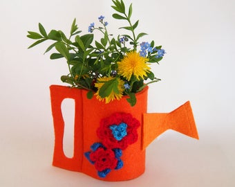 orange watering can planter with crochet flower