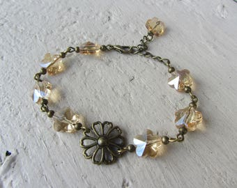 bucolic and romantic, bronze and amber glass beige flower bracelet
