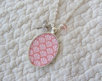 cabochon pendant necklace oval pink paper, glass and Dragonfly charms and silver metal chain
