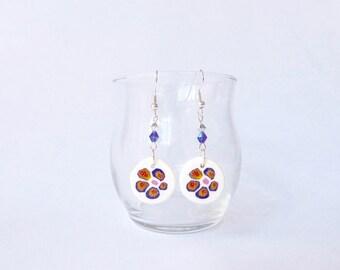 Painted flowers on white pearls earrings purple