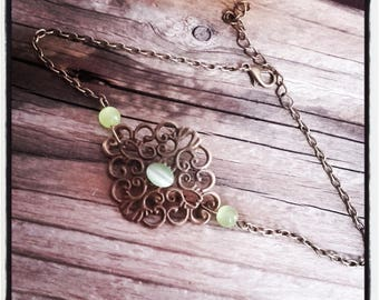 Anklet in antique bronze filigree and green glass beads