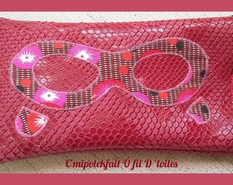 This sunglasses case. faux leather crocodile shaped.. Raspberry .couleur and prints