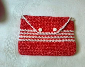 small crocheted pouch lined and closed with two buttons