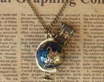 1 pendant of a globe and binoculars on chain