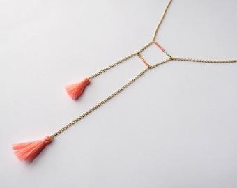 Asymmetrical necklace brass necklace, Miyuki beads and pink PomPoms
