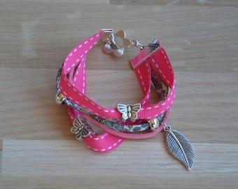 Bracelet multi strand in shades of pink, leaf charm and Butterfly beads