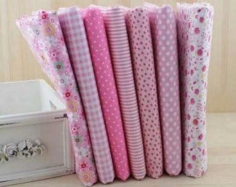 Set of 7 pink and white patchwork fabrics