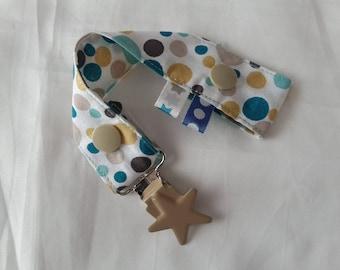 Attache-tétine en tissus avec pression et attache type bretelle - tissus aux motifs géométriques bleu canard, beige et jaune