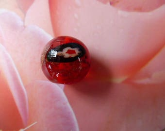 Red lampwork bead with flowers in the heart bead