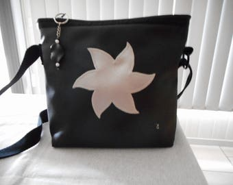 Silver flower and black shoulder bag