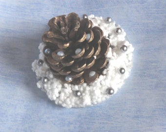 Pine Cone Christmas ornament in the snow