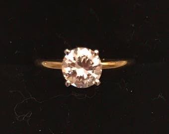 14k yellow gold round solitaire cubic zirconia ring.