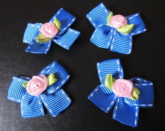 Set of 2 blue bows embellished with a fabric flower handmade