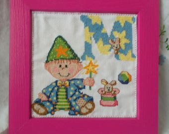 """Wood frame with embroidered """"M"""" baby alphabet"""