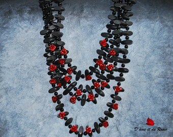 Necklace red roses and black wooden beads in metal