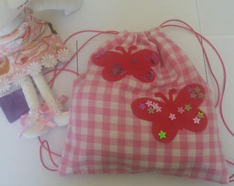 Pink gingham kids backpack and butterflies