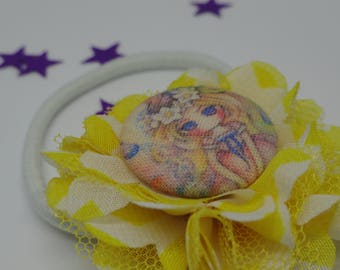 elastic adorned with a yellow rosette flower and cabochon kawaii girl