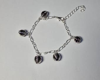 Bracelet charms and purple Hematite in a cage