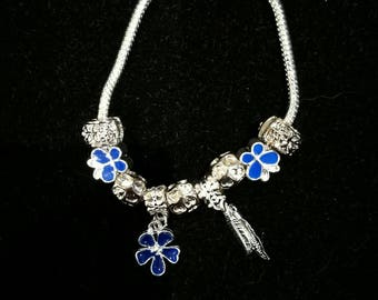 European bracelet with European beads blue, and feather flower