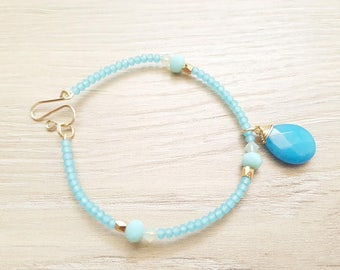 Bracelet by LNDT, adorned with faceted Swarovski® Crystal pearls and a Jade stone