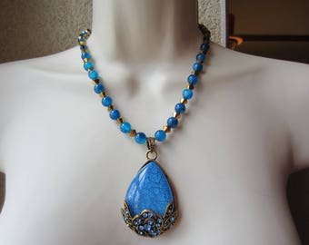 Blue and gold necklace with carnelian beads