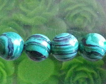 5 8 mm in diameter, hole 1 mm malachite beads.