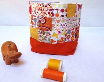 Filled all multicolor and orange patchwork storage basket