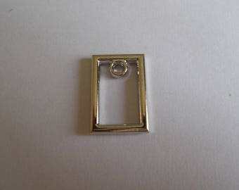 rectangular silver pendant or charm