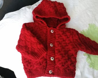 Small hand knitted red vest