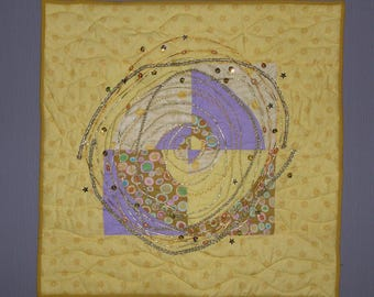 Small patchwork purple and yellow circles