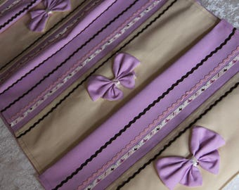Purple and beige non table runner is lined in cotton