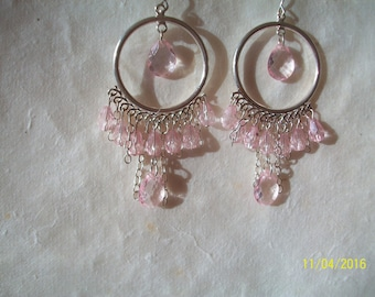 round earring and transparent pink bead