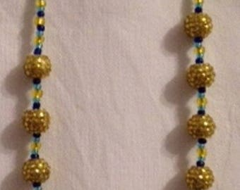 Bright yellow and gold and blue tones necklace