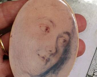 a large part cabochon effect enamel pendant