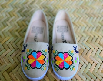 Shoes with hand-crafted embroidery