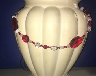 Red and clear statement necklace with ribbon chain