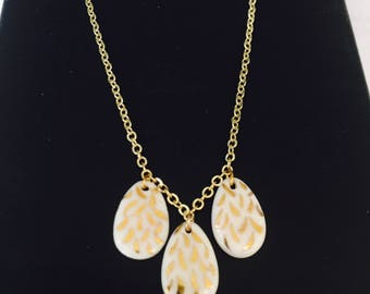 White and gold porcelain necklace