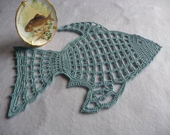 Hand-made blue cotton crochet doily 'fish'.